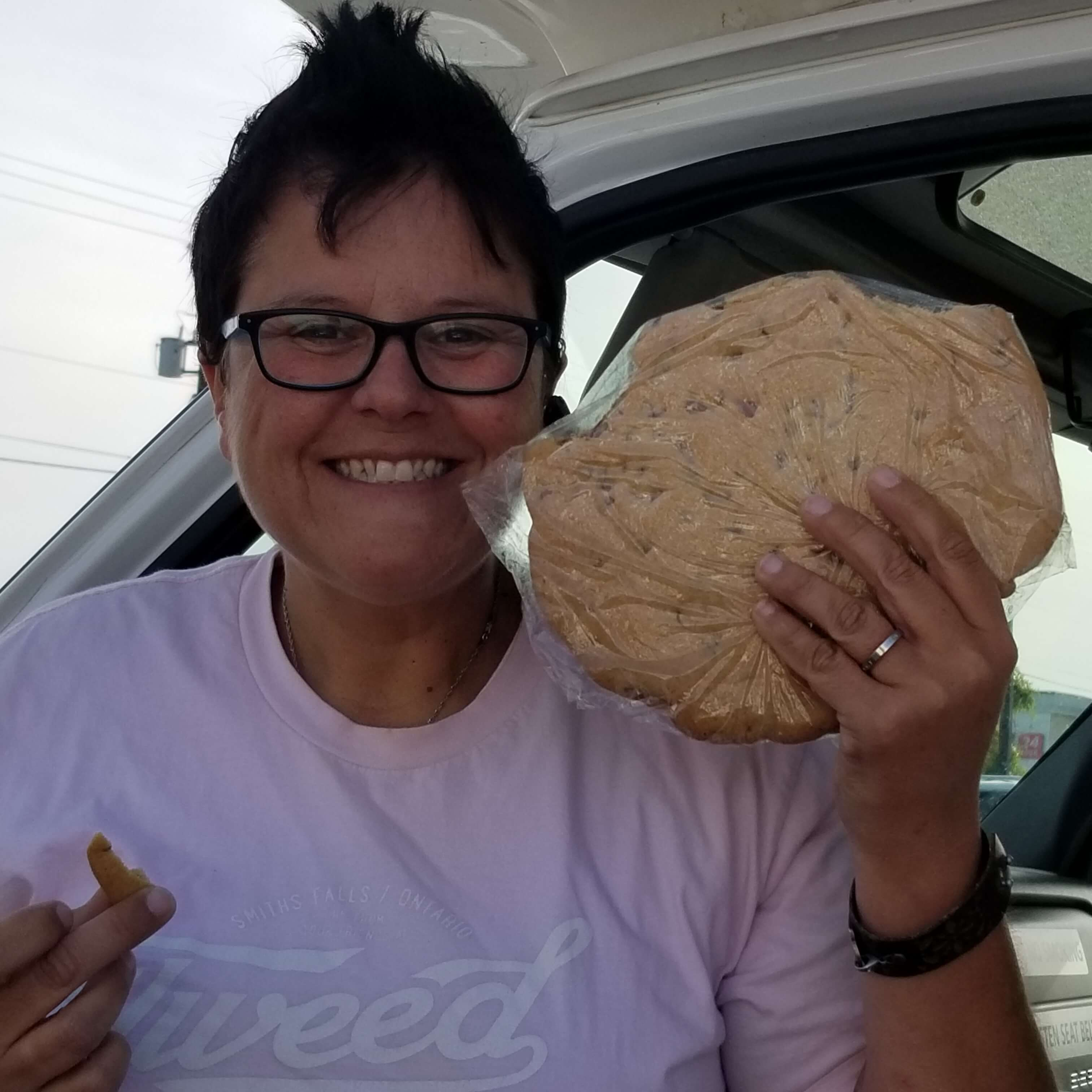 Driver Dianne holding giant cookie